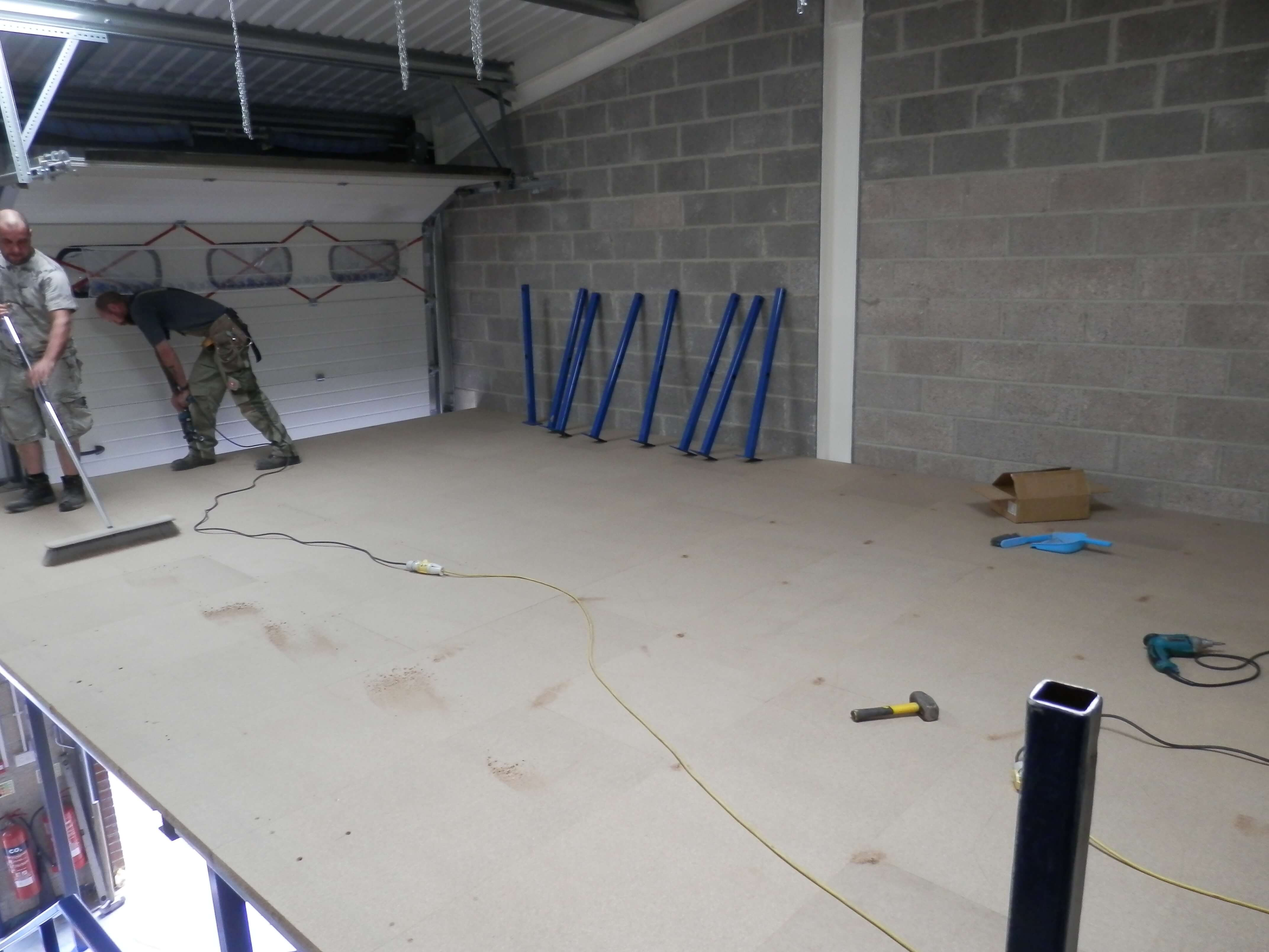 Floor panels being fitted.