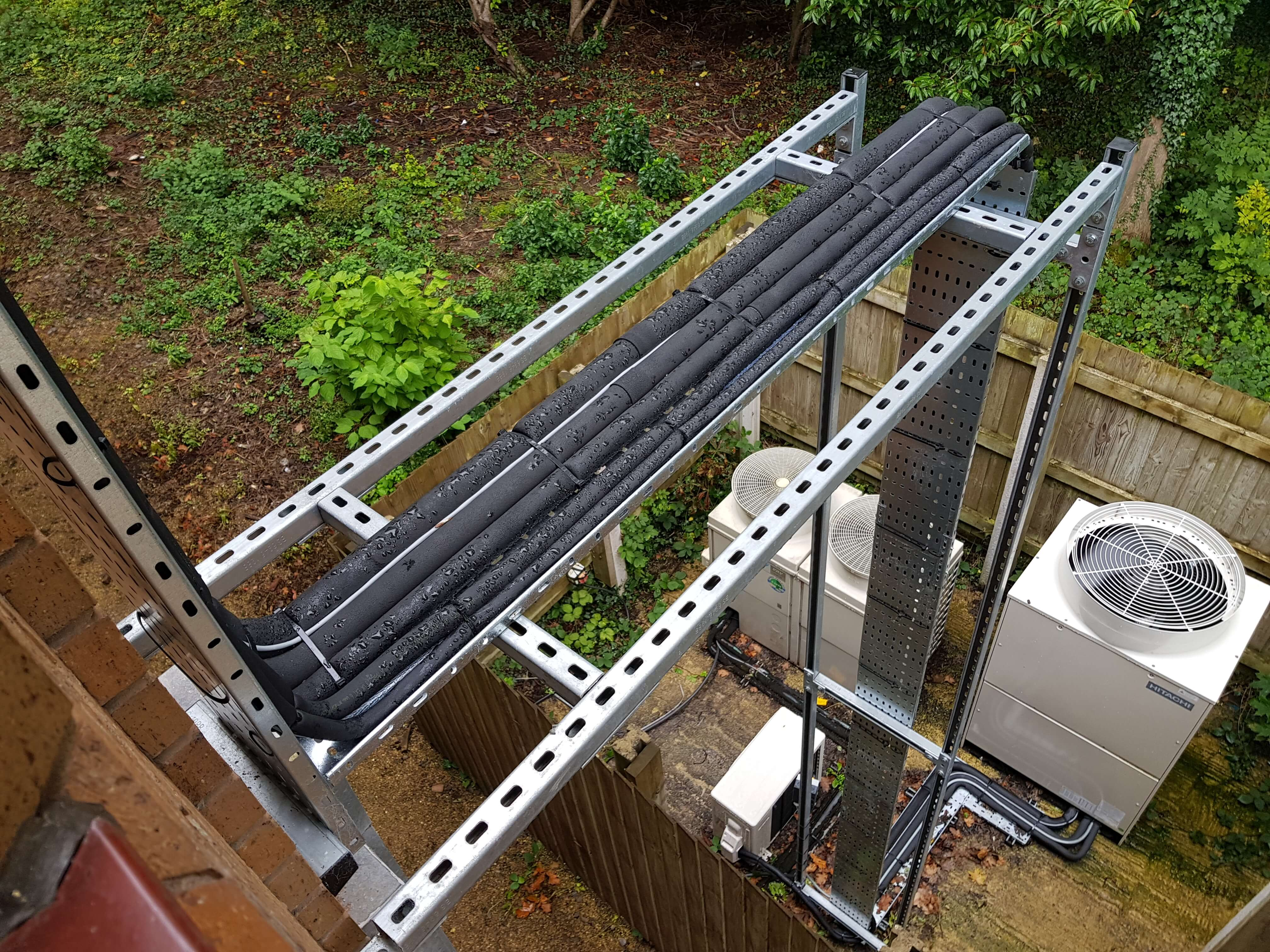 Air conditioning pipework trays installed