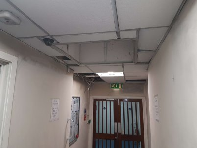 The walls and ceiling in the hallway were damaged by the smoke.