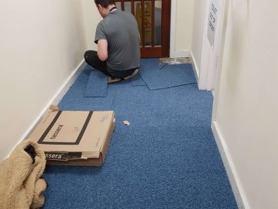 The carpet in the hallway being replaced.