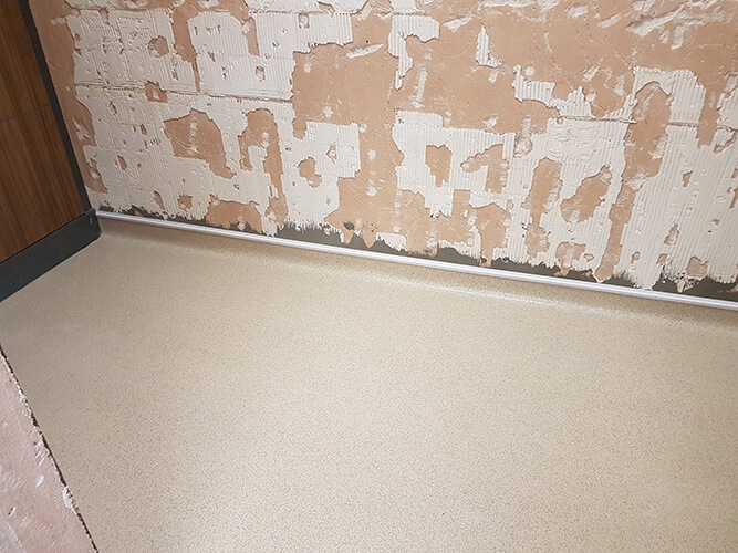Anti-slip vinyl flooring with coved edges for easy cleaning.