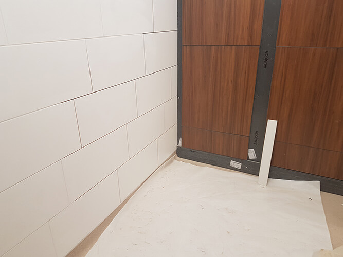 Wall tiling began with large format matt white tiles.