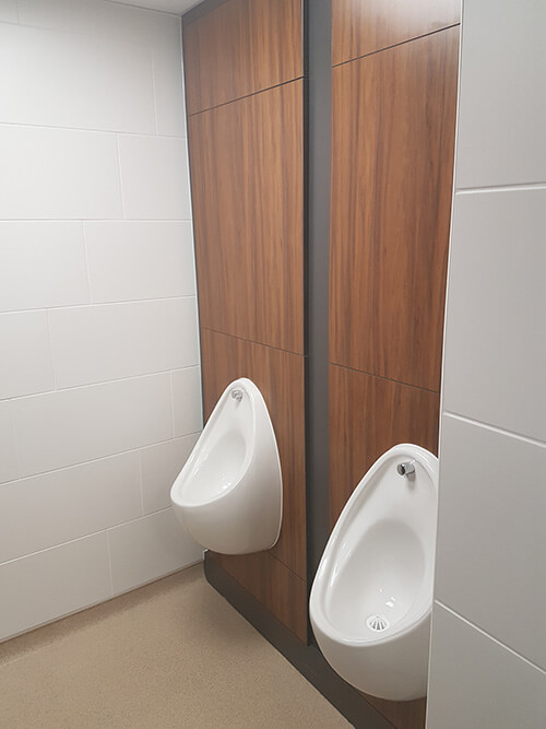 New urinals look modern on the wooden IPS panels.