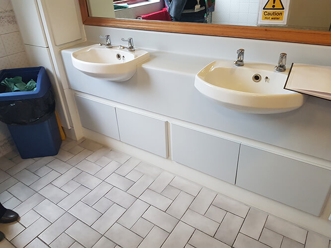 Cre8tive Interiors Washroom and Toilet Refurbishment - replacement sinks and flooring.