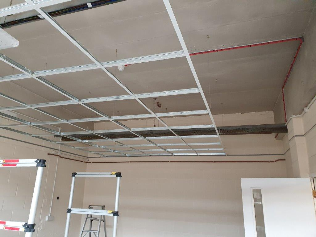 More suspended ceiling grid going in